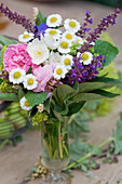 Posy of roses, feverfew and salvia