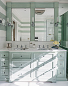 Washstand with drawers in mint-green bathroom