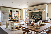 Large kitchen-dining room in English country-house style decorated in cream