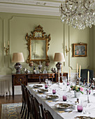 Festively set table in historic dining room