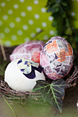 Easter eggs covered with old postage stamps