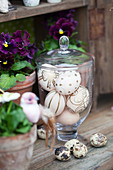 Easter eggs decorated with gold pen in glass sweet jar