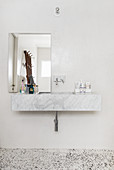 Marble sink and terrazzo floor in bathroom