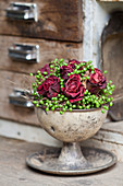 Arrangement of dried roses and unripe berries