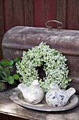White summer wreath with pottery birds