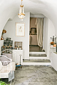 Old metal bed in a Mediterranean vault with nostalgic decoration