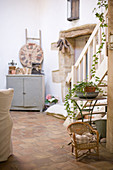 Mediterranean living room with nostalgic deco and terracotta tiles