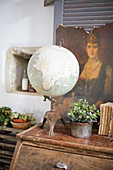 Globe, money tree and junk as nostalgic decoration