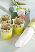 Homemade napkin rings with lace border and yellow paper