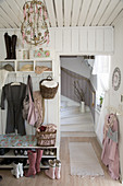 Shoe rack and coat rack in shabby-chic hallway