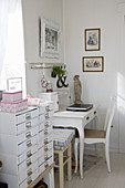Chest of drawers next to desk in shabby-chic style