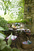Set table in an enchanted garden with a natural stone wall