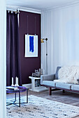 Classic sofa, side table and floor lamp in corner of room