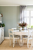 Shabby Chic table and chairs in the dining room with floorboards