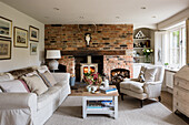 Living room in English country-house style with brick wall