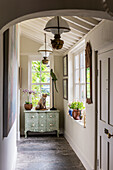 Hallway in the English cottage with beamed ceiling and animal taxidermy