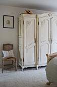 An ornate four-door armoire in the guest bedroom