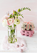 Jar of ranunculus, Easter eggs and egg boxes