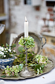 Silver candlestick with green hydrangeas as nostalgic decoration