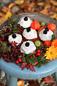 Apple and cinnamon cupcakes with autumn decoration