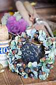 Wreath of blue hydrangea blossoms and berries