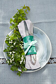 Easter place setting with DIY napkin ring and twig