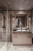 Bathroom with shower area in earth tones