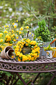 Spring decoration with a wreath of flowers made from Kerria 'Pleniflora'