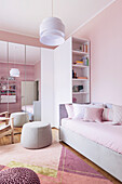 Sofa bed, shelf and wardrobe with mirrored doors in the girls' room