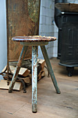 Old, battered stool with peeling paint