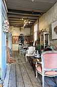 Vintage decorations in rustic interior of dilapidated house