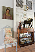 Antique chair, vintage boxes, portrait and console table