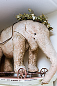 Vintage-style arrangement with old toy elephant on wheels