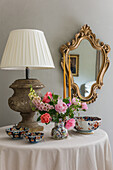 Antique china and lamp on table