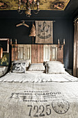 Bed headboard made from old window shutters in rustic bedroom