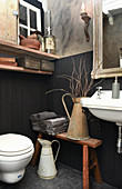Small bathroom with panelled walls and vintage-style accessories