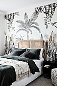 Wallpaper with exotic palm-tree motif in Bohemian-style bedroom