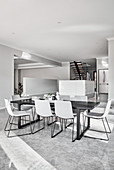 Modern, minimalist, open-plan interior decorated in shades of grey