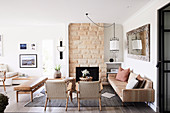 Boho-style living room in natural tones with open fireplace