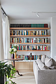 Wall shelves with books in the classic living room