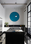 Blue circle on wall of modern kitchen with island counter