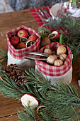 Nuts and small Christmas apples in bags