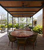 Round wooden tale on roofed terrace in summer