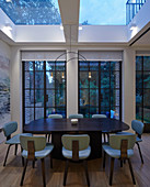 Dining room with lattice windows and skylights at twilight