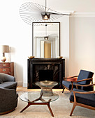 Classic designer furniture and open fireplace in mid-century modern living room