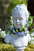 Bust of girl with wreath of forget-me-nots