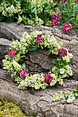 Summer wreath made from privet flowers and carnations