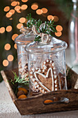 Heart-shaped gingerbread in a glass jar with a lid