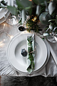 Christmas decoration and fir branch arranged on plate