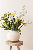 Spring bouquet with tulips, daffodils, goldenrod, and sea lavender